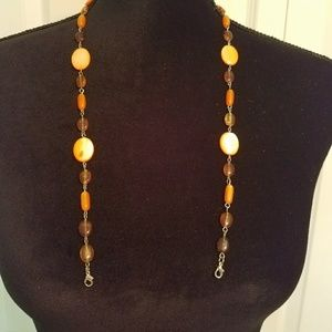 Amber, peach, and light orange eyeglasses chain